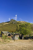 Spain, Galicia, Wind Turbines and Ancient Homestead Royalty Free Stock Photography