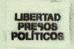 Political graffiti, in the Catalan language, stenciled onto the ground. calling for freedom for political prisoners. in the town o. Spain; Girona; Catalonia; 27 stock images