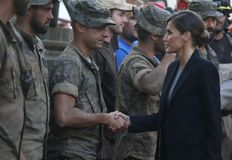 Spain Queen Letizia greets rescue forces in the village of San Llorenc after floods killed many people. Spain King Felipe and Queen Letizia seen greeting the royalty free stock image