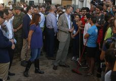 Spain kings talk to villagers in the village of San Llorenc after floods killed many people. Spain Kings Felipe and Queen Letizia visit the village of San stock photos