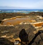 In spain  lanzarote  rock stone sky cloud beach Stock Photo