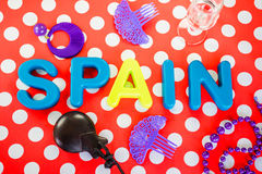 Spain made of plastic letters, castanet and costume jewelry stock photo