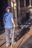 Spain, Madrid, an street-sweeper watering the street Royalty Free Stock Image
