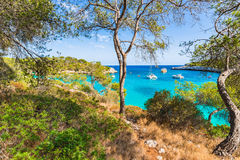Spain Majorca bay of Cala Mondrago beautiful seascape with boats. Idyllic island scenery, Mallorca Spain, beautiful bay with boats at Cala Mondrago Royalty Free Stock Images