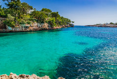 Spain Majorca Cala Serena. Beautiful seaside on Mallorca island, idyllic bay coast of Cala Serena in Cala D`or, Mediterranean Sea, Balearic Islands Royalty Free Stock Photos