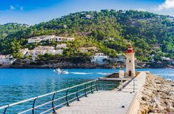 Spain Majorca island, view of lighthouse at mole at bay of Port de Andratx. Lighthouse in Port de Andratx on Mallorca island, Spain Balearic islands stock photos