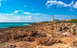 Spain Majorca Lighthouse at Cap de Ses Salines. View of the lighthouse at Cap de Ses Salines on Majorca island, Spain Mediterranean Sea, Balearic Islands Royalty Free Stock Photo