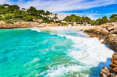 Spain Mallorca, beach at beautiful bay of Cala Anguila. Mallorca beach of Cala Anguila, idyllic bay seaside, Spain Balearic islands, Mediterranean Sea Stock Photos