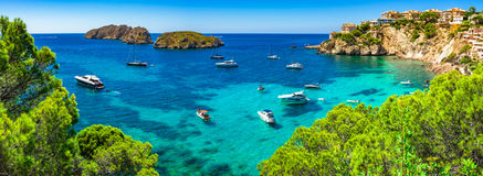 Spain Mallorca, beautiful panorama seascape, bay with boats at Santa Ponsa coast. Majorca Panorama, beautiful seascape bay with luxury yachts at the coast of Royalty Free Stock Photography