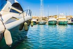 Spain Mallorca island, luxury boats at marina of Port de Alcudia. Marina at bay of Alcudia on Mallorca island, Spain Mediterranean Sea Royalty Free Stock Image