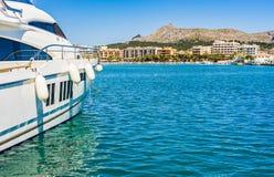Spain Mallorca island, seaside of Port de Alcudia bay. Luxury yacht anchored in mediterranean marina on Mallorca island, Spain Royalty Free Stock Image