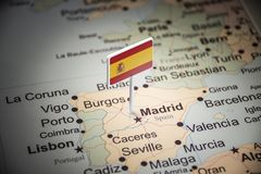 Spain marked with a flag on the map.  royalty free stock images