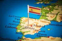 Spain marked with a flag on the map.  stock image