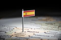 Spain marked with a flag on the map.  royalty free stock photo