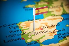 Spain marked with a flag on the map.  stock photography