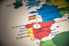 Spain marked with a flag on the map.  stock photos