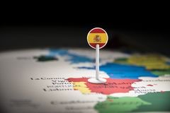 Spain marked with a flag on the map.  stock photo