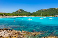 Spain Mediterranean Sea Coast Majorca Beach Cala Agulla. Beautiful bay with tropical turquoise clear water and sailing yachts at the beach of Cala Agulla Royalty Free Stock Images
