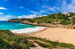 Spain Mediterranean Sea, Majorca beach at beautiful seaside of Cala Anguila. Mallorca beach of Cala Anguila, idyllic bay seaside landscape, Balearic islands Royalty Free Stock Photos
