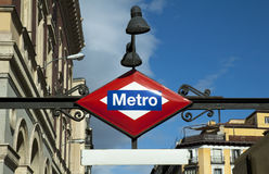 Spain. Metro sign station and old classic buildings. Royalty Free Stock Photo