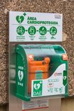 Defibrillator box hanging outside on a wall. SPAIN, MONTSERRAT - SEPTEMBER 11: defibrillator box hanging outside on the street in Spain on September 11, 2015 royalty free stock photography