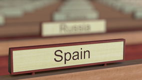 Spain name sign among different countries plaques at international organization. 3D rendering Royalty Free Stock Photography
