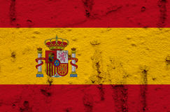 Spain National Flag On Grunge Wall Background. National  Flag of Spain on Abstract Grunge Wall Background Stock Photo