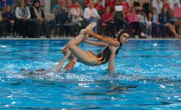 Synchronized swimming exhibition air figure. Spain national olympic synchronized swimming team performs during an exhibition show in the Spanish island of Royalty Free Stock Images