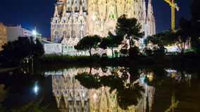 Spain night light barcelona sagrada familia pond reflection 4k time lapse