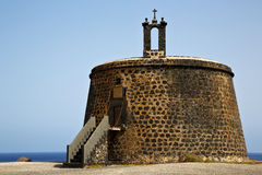 Spain the old wall castle  tower r  in teguise arrecife lanzaro Royalty Free Stock Photography
