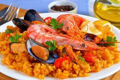 Spain paella with king prawns, mussels Royalty Free Stock Image