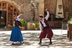 Dance with castanets. Spain Palma de Mallorca June 23, 2016: Dances with castanets of two graceful dancers in old costumes at the estate Camino de Caledor. San Stock Photos