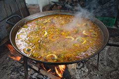 Spain, a pan of Paella cooking over charcoal royalty free stock photos