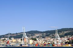 City view of Vigo with container terminal in seaport Royalty Free Stock Image