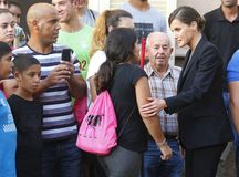 Spain Queen Letizia talks to villagers in the village of San Llorenc after floods killed many people. Spain King Felipe and Queen Letizia visit the village of royalty free stock photo