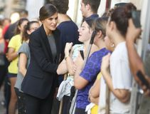 Spain Queen Letizia talks to villagers in the village of San Llorenc after floods killed many people vertical. Spain King Felipe and Queen Letizia visit the stock image