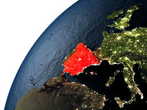 Spain in red on Earth at night Royalty Free Stock Photo