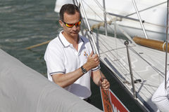 Spain Royal King Felipe arriving at the nautical club to sail sailboat during the king`s cup. stock photos