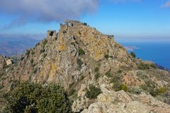 Spain castle ruins at top of steep rocky spur Royalty Free Stock Photography