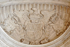 Spain's national emblem. Stone sculpture, taken in early May 2010 Royalty Free Stock Image