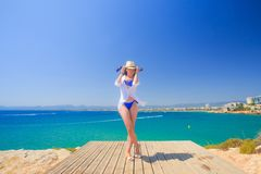 Spain, Salou. Tourist girl in blue bikini at the sea. stock photography