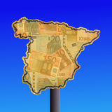 Spain sign with cash. Warning sign in shape of Spain with euros Royalty Free Stock Photography