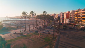 Spain sitges sunset panoramic view on tourist walking bay square 4k time lapse. Spain sitges sunset panoramic view on main tourist walking bay square 4k time stock footage