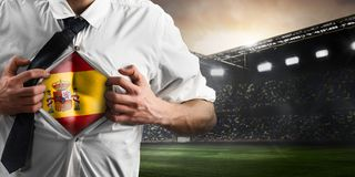 Spain soccer or football supporter showing flag. Under his business shirt on stadium royalty free stock image