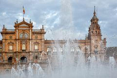 Spain Square Plaza de Espana is in the Public Maria Luisa Park, in Seville, view through the fountain. Spain Square Plaza de Espana is in the Public Maria Luisa Royalty Free Stock Images