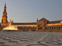 Spain square in Seville at dusk Stock Photography