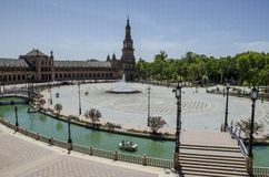 Spain Square in Seville, Spain, Europe. The red color Spain Square in Seville, Spain, Europe. A  landmark example of the Renaissance Revival style in Spanish Stock Image