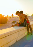 Spain summer holidays. Young People enjoying the beach at sunset. Rota, Cadiz Stock Photography