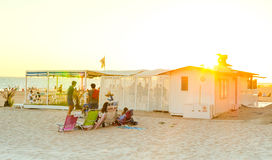 Spain summer holidays. Young people enjoying the beach at sunset. Rota, Cadiz. Royalty Free Stock Photography
