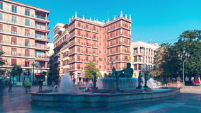 Spain sun light valencia cathedral square fountain 4k time lapse. Sun light valencia cathedral square fountain 4k time lapse spain stock footage
